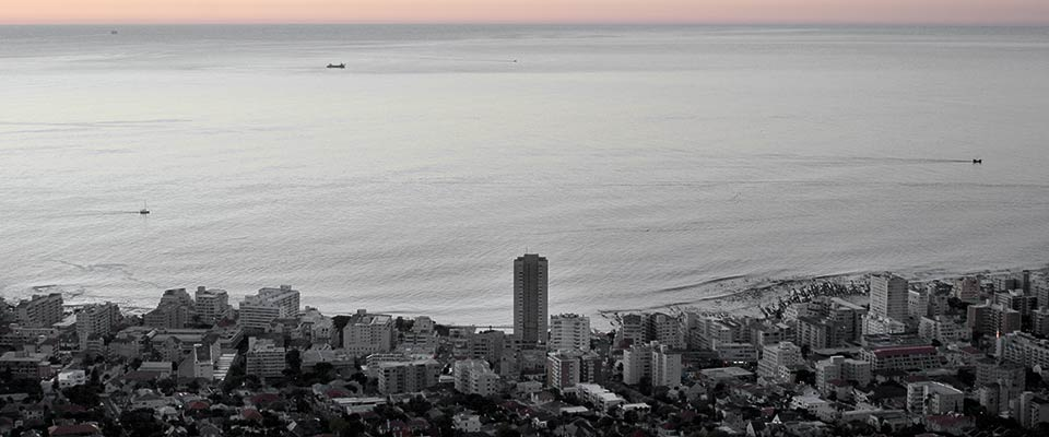 Photo: View of Sea Point and Table Bay. The margins of Robben Island (where Nelson Mandela was imprisoned) are fainting on the right. Cape Town, April, 2011
